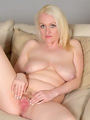 Mature first timer with big natural tits rubs her juicy snatch