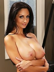 Busty Ava Addams seduces younger guy by changing into a sexy outfit and fucking the guy on the couch.