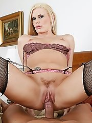 Blonde milf Darryl Hanah wakes up her husband with a nice breakfast of fruit and a good lay.